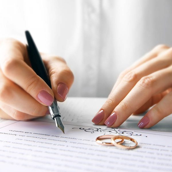 Woman Signing Marriage Contract Closeup