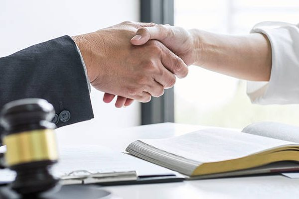 Good Attorney Shaking Hands with Client