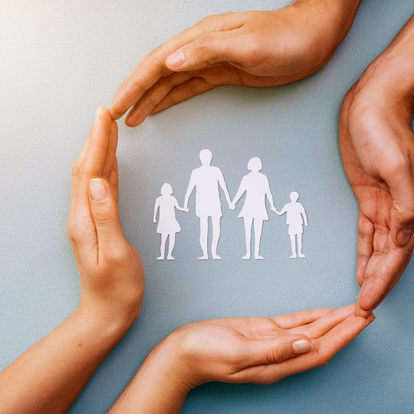 Two pairs of hands protecting family, children